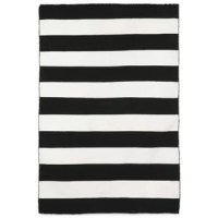 Walls aren't the only places to show off your personality with art. Your floors are craving personality too! That's when area rugs come in. Whether rolled out at the center of your living room, underneath your dining table, or in your master suite, area rugs act as both a foundation and a focal point. This one, for example, features a black and white striped pattern, perfect for a traditional aesthetic. It is handmade from polyester and can be used outdoors as well as indoors.