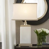 The Madison Park signature Colette Table Lamp is made to light up every living space. With its elegant silhouette and stylish ribbon trim shade, this table lamp will be a perfect addition to your living spaces.