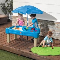 Little ones can make believe they're sailing the Seven Seas and then arrive on an island to dig for buried treasure with this sand and water table. This brightly colored all-in-one activity table provides sensory play fun for all! Kiddos can build sandcastles on one side and sail toy boats on the other. This kid's sand and the water table is a great outdoor toy that provides children with hours of imaginative play fun. Let the splashing and building fun begin with Step2.