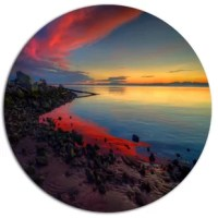 Bring contemporary abstraction to your home with this circle metal wall art. This modern Blasts of Color at the Sunset metal artwork makes it the focal point of any room or office.