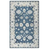 Showcasing a classic Persian-inspired motif in subdued blues and beige hues, this dynamic area rug offers a pop of pattern that won't overwhelm your existing arrangement. Crafted in India from 100% wool, it's well suited to sit in high-traffic rooms inside your home. Though this piece's long 1