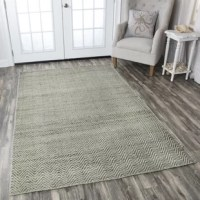 From anchoring the living room and sprucing up a stale master suite, to simply adding warmth to hardwood and tile floors, there's really nothing area rugs can't do! This rug, for example, is a great option for adding an understated contemporary style to your home thanks to its understated herringbone pattern and neutral hue. Handwoven in India from jute and wool, this piece makes the most of natural fibers for an eye-catching look that can stand up to regular use. A 0.32'' pile height makes...