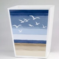 Made of wood painted bright white with a decal depicting Tietons flying through a beautiful blue sky, this Tieton Wood Trash Can add a subtle touch of the sea to any room in the house.