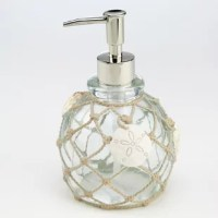 Created in clear, blue-green resin with hand-painted ropes and shells, this Seaglass Lotion and Soap Dispenser brings a beautiful touch of the sea to any bathroom or kitchen.