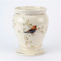With its classic shape decorated with raised, colorful birds and branches and finished with gold trim, this Trash Can adds a touch of elegance and sophistication to any room in your home.