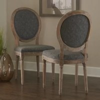 This Side Chair has a French-inspired design and style. Crafted from elm, the frame has a light natural brown finish and is accented with detailed carvings. Upholstery graces the seat and chair back.
