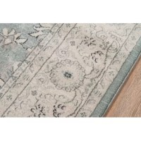 Made to emulate popular one-of-a-kind Chobi designs and silver-wash colors, this ultra-chic area rug lends flea-market-found flair to your space. Machine woven in Turkey from stain-and-fade-resistant polypropylene pile, this alluring design showcases an ornate botanical motif in soft hues of powder blue and beige. Establish a chic French country aesthetic in the entryway by rolling this rug out to welcome guests with a pleasant pop of pattern, then set a weathered sideboard with louvered...