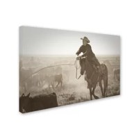 This ready to hang, gallery-wrapped art piece features a cowboy lassoing cattle in an open field. Giclee (jee-clay) is an advanced printmaking process for creating high quality fine art reproductions. The attainable excellence that Giclee printmaking affords makes the reproduction virtually indistinguishable from the original piece. The result is wide acceptance of Giclee by galleries, museums and private collectors. Gallery wrap is a method of stretching an artist's canvas so that the canvas...