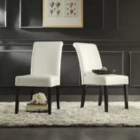 A traditional silhouette gets a streamlined update in this upholstered dining chair! Founded on an Asian hardwood frame, this chair strikes a parsons-style silhouette with a rolled back, box seat, and tapered legs. Enveloped in easy-to-clean faux leather upholstery, this chair features accent stitching for a tailored touch, while cushioned padding provides comfort and support. Measuring 39.2