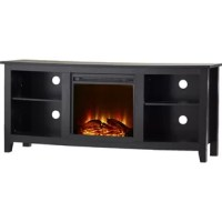 Create a warm, entertaining space in any room of your home with this wood media stand and electric fireplace. Crafted from high-grade MDF with a durable laminate finish to accommodate most flat-panel TVs up to 60 inches.