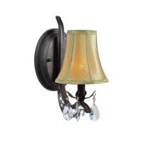 This classic wall lamp showcases a dark bronze finished metal frame with clear crystal ornaments that interact with a beige fabric shade. Perfect for your hallway, bedroom, and kitchen.