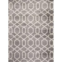 This beautiful rug is unique, stylish, and ready to accent your decor with authentic elegance. This rug features bold colors and modern design. This rug has a heavy, dense pile as well as a heavy surface texture.