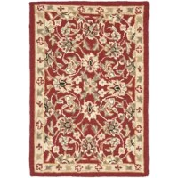 A sure cure for the bare floor blues, area rugs anchor a living room ensemble while softening the step of hardwood and tile. This design sports an intricate, Persian-inspired motif, perfect for modern and traditional homes alike. Hand-hooked from wool with a low 0.25'' pile height, it's a crush-resistant piece that's suited for well-traveled areas in your home. If any loose ends occur, clip them with scissors. We recommend a rug pad for added stability.