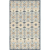 Hand-hooked wool rug with a floral trellis motif.