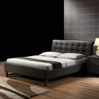 The Corrigan Studio Chandler Upholstered Panel Bed give a trendy makeover for your bedroom with its classy design. This bed is faux leather upholstered with a button tufted headboard and tapered wooden legs. This Panel bed is a great addition to a modern room setting. The frame of the bed is constructed from Corrigan Studio wood, which makes it sturdy and long-lasting. This bed features 10 slats that are made from engineered wood and it provides great support for the mattress.