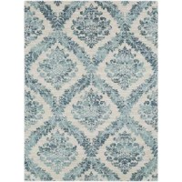 Whether you're adding a bit of visual intrigue to your well-curated entertainment space or setting down the anchor for your welcoming den, this eye-catching area rug is the perfect pick for your abode. Featuring a  striking, Oriental-inspired floral motif awash in dark blue and teal tones, this piece brings a soothing, garden-chic touch to your look, while the woven polypropylene design makes it a durable addition to the aesthetic. Let it anchor your living room seating group, or add it to the...