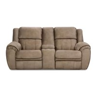 Kick your feet up as you lounge beside a friend with this double motion reclining loveseat, a transitional design that's right at home in a living room where traditional and contemporary styles meet. Crafted in the United States with a wood frame, this tan piece features sinuous spring seats, pillowtop arms, and embossed, knitted velvet upholstery with a fleece backing. This versatile seat is complete with a center storage console with two cup holders, so you can easily set down your cocktail...