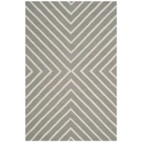 """Set a soothing foundation for your little one's space with this area rug, showcasing a concentric """"X"""" motif in calming hues. This area rug is perfect for rolling out in a calming nursery or a delightful playroom."""