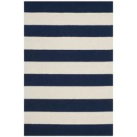 Ideal for lending a space a soft touch, area rugs like this one are a great way to round out space with a decorative touch that also protects your floors. This piece showcases an eye-catching navy and ivory striped pattern for an understated patterned accent. This piece is perfectly plush underfoot, while still staying easy to maintain.