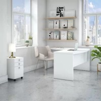 Deferiet Bow Front Desk 3 Piece Set creates a strong presence perfect for those whose passion for business is only matched by their fashionable tastes. Blending a Pure White finish with appealing wide lines, the contemporary Desk inspires and gives a residential feel to the modern workspace. Thick and durable, a thermally fused laminate finish ensures years of everyday use to maintain the elegance of the White Desk. Spread out on the spacious L-Shaped surface with your computer, paperwork or...