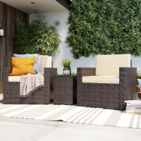 Perfect for petite patios, this three-piece conversation set lets you sit beside a loved one and soak up some sun. Crafted with a steel frame, each weather-resistant piece is wrapped in dark brown resin wicker with woven details for a breezy and understated look. Neutral-hued cushions with removable polyester-blend fabric cover top both armchairs to provide 4