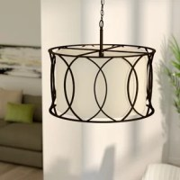 Traditional design gets a contemporary update in this three-light chandelier. Finished in classic oil-rubbed bronze, this design's steel frame features an overlapping oval pattern that casts shadows on a clean-lined drum shade within. Versatile and adjustable, this piece comes with five feet of chain to hang it from multiple heights, and a removable frosted glass diffuser for a softer incandescent glow. Install this light in your open concept eat-in kitchen to brighten up weekend brunches and...