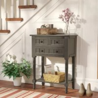 Bring a cottage-chic style to your space with this small console table. Crafted of a solid and manufactured wood in a handsome finish, this console table features simple moldings beadboard panel details, metal ring hardware, and turned post legs. Three drawers offer plenty of storage space for smaller accessories, while an open lower shelf is great for stacking books or clustering collected curios.