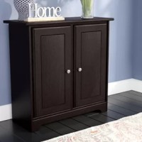 Crafted of solid and manufactured wood in a rich woodgrain finish, this storage cabinet strikes a rectangular silhouette with simple moldings, recessed paneling, and an arched apron kickplate. Set on soft-close Euro hinge hardware, two doors open to reveal adjustable shelved storage for everything from books and board games to barware and fine china, while the smooth top surface provides a perfect platform for framed photos, a vase of fresh flowers, or a stylish lamp.