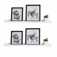 Display framed photos and collected curios in streamlined, space-saving style with this two-piece set of floating shelves! Crafted of manufactured wood in a matte painted finish, each shelf strikes a rectangular silhouette measuring 48