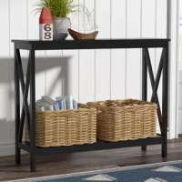 A traditional silhouette gets a contemporary update in this simply-chic console table. Crafted of manufactured wood in a classic painted finish, this console table features chunky moldings, open X-shaped side panels, and four straight square legs. One clean-lined lower shelf is great for displaying everything from rows of your go-to reads to fanning out issues of your favorite magazines, while the smooth tabletop provides a perfect platform for framed photos and collected curios.
