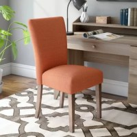 Rounding out your decor while providing sensible seating arrangements in small spaces, side chairs offer style and versatility to any interior design. Take this one for example: Lending a touch of mid-century-inspired style to your office or dining room, it showcases an iconic Parsons design and features foam filling inside its polyester blend upholstery. Founded atop four wood legs, its seat and straight back boast a solid coloring for a look that easily blends with your current color palette.