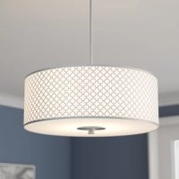 As much a modern art piece as it is a source of light, this three-light drum pendant is sure to collect compliments as it illuminates any arrangement. Crafted of metal in a sleek brushed nickel finish, this fixture features a round canopy, adjustable slender downrods, and a cylindrical shade with geometric overlay for a pop of pattern. A white etched glass diffuser completes the look and softens the brightness of three 75 W medium-base incandescent bulbs within. The manufacturer backs this...