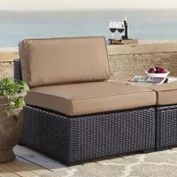 Excellent addition to any outdoor seating ensemble, this armless chair is founded on a durable steel frame wrapped in UV-resistant resin wicker in a deep brown finish. A contemporary silhouette defines the design with a boxy base, a straight back, and four tapered block feet. Available in a selection of curated colors, matching cushions made from solution-dyed polyester feature high-grade cushion cores and piped corners for a weather-resistant and comfortable seat.