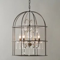 A birdcage shade houses this elegant four-light pendant, defined by its cascading crystal-inspired details and rich black finish. Its open design adds a breezy touch to any space while its candle-inspired bulbs bristle with traditional appeal. Lean into this piece's French country influences by adding it to a living room comprised of skirted sofas and deep-tufted armchairs, then anchor the arrangement with a linen-upholstered cocktail ottoman, perfect for displaying a bowl of faux fruit or an...