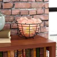 "Sit back and relax in the pristine glow created by this wired basket 8.5"" salt rock lamp. A perfect option for the bathtub, jacuzzi, or bedroom, this table lamp is sure to engulf you in warm and serene ambiance. Handcrafted in the USA from 100% pure Himalayan salt—no two are the same—it has a unique shape and displays a gorgeous amber color that produces a tranquil glow that looks elegant with most decors. Establish a worldly aesthetic in your living room by rolling out a Tibetan-inspired..."