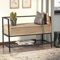 Don't choose between fantastic function and modern farmhouse flair – bring both to your home with this clean-lined entryway bench. Founded atop a black-finished metal frame, its manufactured wood seat features an oak finish and a conveniently hidden storage compartment to stash hats, gloves, and other on-the-go essentials. A slatted shelf down below completes the design, providing a place for shoes, magazines, and more. Thanks to its neutral hues and compact silhouette, this versatile piece...