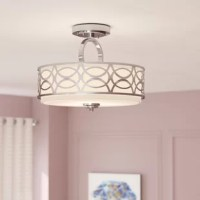 Light up any space in style with this semi-flush mount. It features a cylindrical metal frame decorated by a geometric cutout pattern and a frosted glass diffuser that helps spread the light of a trio of bulbs. Since this luminary mounts so closely to the ceiling, it's a great fit for smaller spaces such as bathrooms and hallways. It accommodates 60 W maximum bulbs (not included) and is even compatible with a dimmer switch.