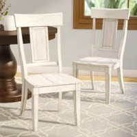 Bring French cottage style to your dinner table with this side chair. Crafted of solid and manufactured wood in a rich finish, this side chair has a paneled backrest and four tapered square legs. Rounding out the design, the gently-contoured seat offers added comfort and support. This side chair is 17.1