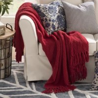 A classic knitted design pair with a chevron color pattern to round out the essential throw blanket. Use it in the master suite to complement a contemporary ensemble or add it in the den to level out a beachy coastal look. A subtle diamond motif gives this option a pop of pattern while it is fringe trim gives a timeless design that blends effortlessly into any ensemble. Use it in the living room to curl up with your favorite novel and a cup of tea, or drape it over the back of an armchair for a...