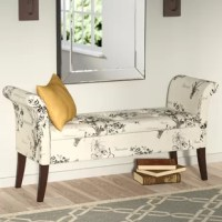 Create an instant place to lounge in the master suite while adding must-have storage with this bench! Founded atop curved legs, its wood frame is wrapped in fabric upholstery and features two rolled arms and button-tufted details on the seat for traditional flair. Flip the top up to reveal ample space for stashing spare linens, clothes, or anything else you'd like to have close at hand but out of sight. After assembly, this bench seats two people.