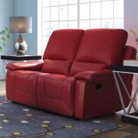Outfit your favorite seating group in sophisticated style with this foam-filled reclining loveseat, an eye-catching addition to any casual or formal space. Its faux-leather upholstery adds a refined touch to any aesthetic while its curved back adds visual appeal to your decor. Play up this piece's contemporary influence by adding it to a living room ensemble alongside a streamlined settee and wingback chairs for a cohesive ensemble, then accent it with an embroidered patchwork pillow for a...