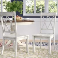 """Bring French cottage style to your dinner table with this side chair. Crafted of solid Asian rubberwood in a rich finish, this side chair has a double """"X"""" backrest and four tapered square legs. Rounding out the design, the gently-contoured seat offers added comfort and support. This side chair is 16.93"""
