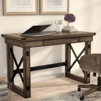 Clean-lined yet rugged, this handsome writing desk is a fine fit for industrial-inspired spaces. Crafted from a mix of solid and manufactured wood, it features an x-shaped base that plays up its openwork design, while wood grain details bring in a bit of natural appeal. A single drawer offers space to stash all your workday must-haves, while a 47.48'' W top is the perfect perch for your laptop and a few decorative accents.