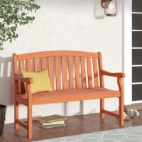 Streamlined and stylish, this traditional garden bench boasts an arch-back design and a timeless silhouette. Made from solid eucalyptus wood in a natural oil-rubbed finish, this weather-resistant design sports a classic slatted backrest a gently contoured seat. To create an inviting outdoor seating ensemble on your back patio, start by rolling out a tonal striped all-weather area rug to define the space, then arrange this winsome bench and two wicker arm chairs around a teak coffee table....