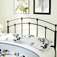 A streamlined take on a traditional design, this open-frame metal headboard effortlessly elevates any bedroom in your well-appointed home. Made from tubular metal in a classic black finish, this charming headboard includes a slatted rod motif, a gently arched silhouette, and decorative ball finials for a timeless aesthetic. To create a classic ensemble in your guest bedroom, start by rolling out a colorful medallion area rug for a pleasant pop of pattern, then place a mahogany nightstand with...