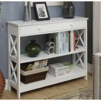 Equal parts simple storage solution and display stage, this understated and essential console table brings a bit of low-key style and timeless looks to your space. Featuring an openwork MDF wood design with open x details, this piece makes a timeless addition to your space, while its single, long drawer and two tiers of shelving let you stow and display in style. Use the shelves to keep baskets of entertainment essentials or stack hardcover novels, or then open up the drawer to keep odds and...