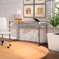 Whether you're looking to make the most of an unused corner of the living room, or round out your home office, this desk is a great option for anchoring your workspace in sleek style. Crafted from tempered glass surfaces founded on a metal base with a silver finish, this desk is a great option for a clean-lined modern look anywhere. Measuring 30'' H x 47.25'' W x 23.5'' D, this piece is a great option for cramped spaces.
