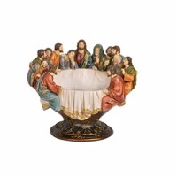An artful addition to any kitchen counter or curio cabinet, this eye-catching bowl brings a sense of spirituality to your ensemble. Measuring 12.25'' H x 15'' W x 12'' D overall, this piece showcases a sculpture of the last supper with Jesus and his apostles seated around the opening where you can keep a collection of keys. Made from polyresin, this novelty design is not safe to put in the microwave or dishwasher.