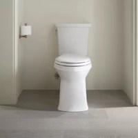 The Corbelle two-piece toilet delivers powerful, clean swirl-style flushing in a sleek skirted design. Kohler's most complete flush ever, revolution 360 swirl flushing technology keeps your bowl cleaner longer than a conventional flush. Installation is easy with the DryLock™ system: the skirted trap-way installs to the floor flange and attaches to the toilet, eliminating the need to drill holes while offering the same secure installation as non-skirted toilets. This WaterSense®-labeled...