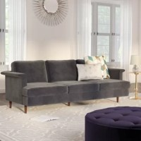 Perfect for gathering everyone together for game night or to curl up for a movie marathon, your sofa is the anchor of your living room's seating and style. So get the best of both with a piece like this! Perfect for adding a chic look to your ensemble, this piece is crafted from a solid frame wrapped in velvet upholstery with foam filling. A clean-lined design, tapered legs and welted stitching round this piece out with an on-trend touch of mid-century-inspired style, perfect for an old...